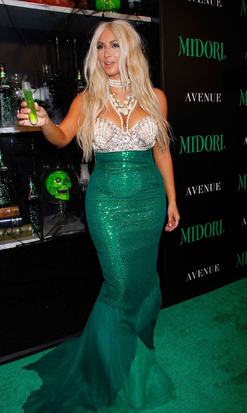 KIM & KANYE MAKE A SPLASH MIDORI GREEN HALLOWEEN | Jones Magazine